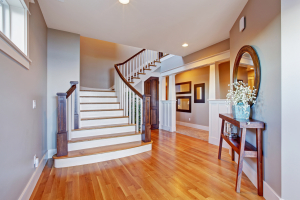 Bright hallway with wooden staircase